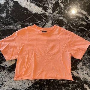 Bright orange crop top T shirt